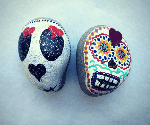 stone painted day of the dead skulls